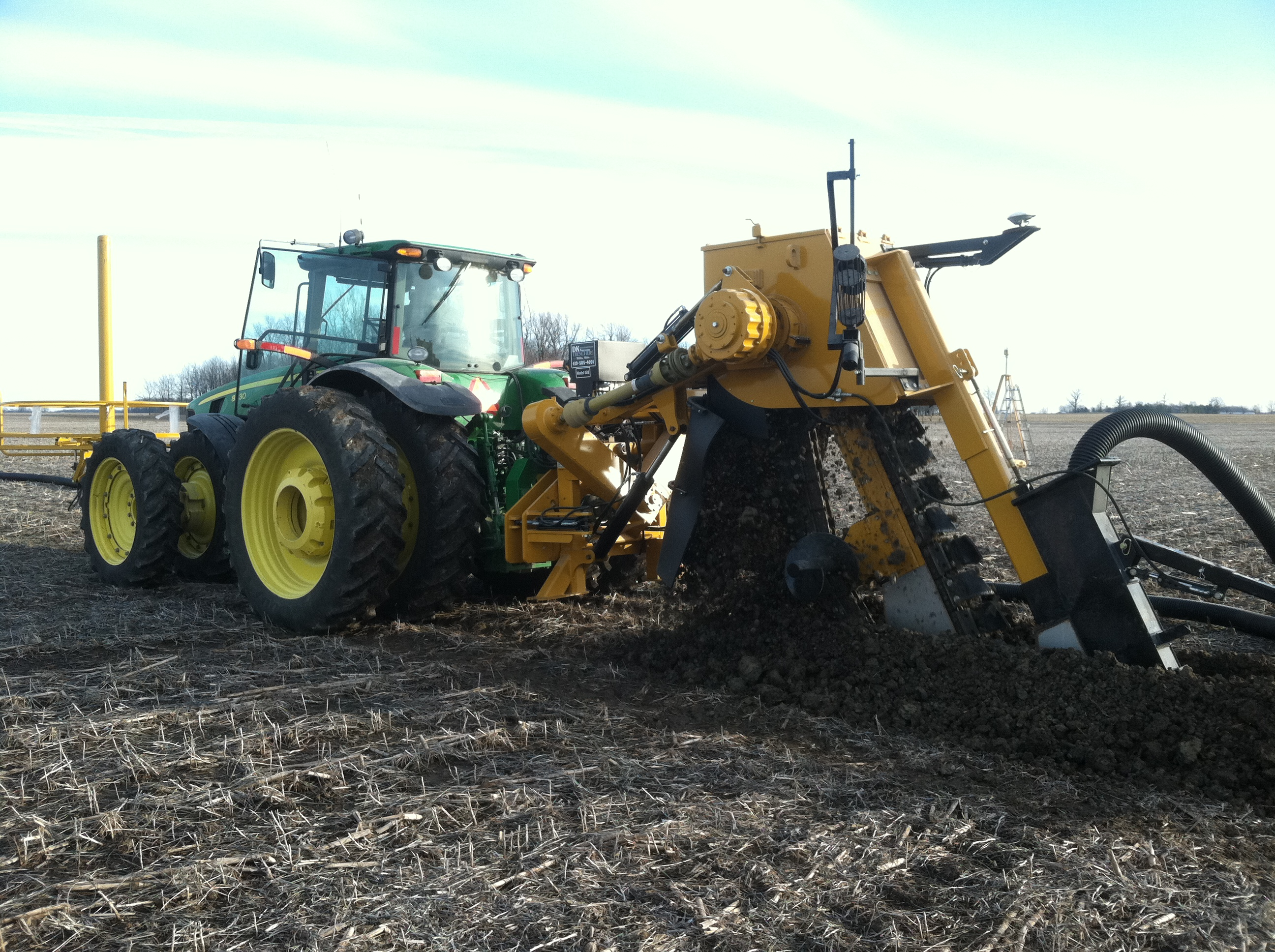 John Deere 8000 with DK Trencher and FmX and AutoPilot